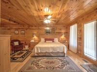 BEDROOM (KING BED) at SNUGGLED IN in Sevier County TN
