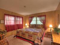 BEDROOM 1 (MAIN LEVEL) at A PIECE OF PARADISE in Gatlinburg TN
