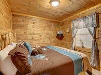 BEDROOM 1 (MAIN LEVEL) at MISS BEE HAVEN in Sevier County TN