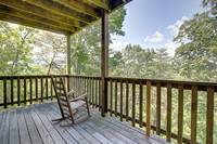 DECK (DOWNSTAIRS) at ABOVE THE TREE TOPS in Pigeon Forge TN