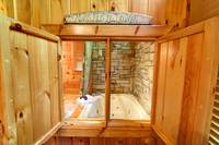 WINDOW FROM BEDROOM TO JACUZZI at TRANQUIL MOMENTS in Sevier County TN