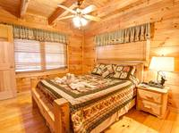BEDROOM 1 at COVE CREEK LODGE in Pigeon Forge TN