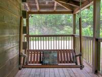 SWING ON DECK at A HIBERNATION STATION in Pigeon Forge TN