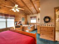 MASTER BEDROOM (UPSTAIRS) at GRINNIN BEARS in Pigeon Forge TN