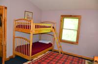 Set of twin size bunk beds located in top level bedroom