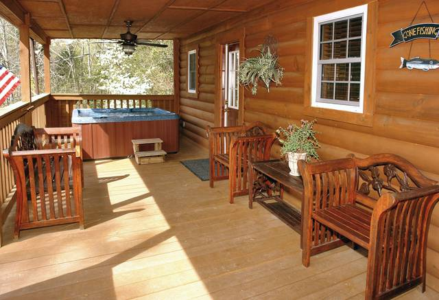Gatlinburg Cabin Rentals_Tranquility_large covered deck with hot tub