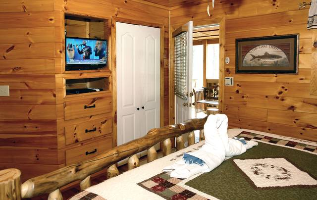 Gatlinburg Cabin Rentals_Tranquility_master suite with tv
