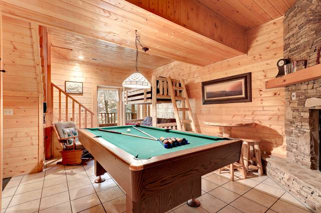 log cabin with pool table