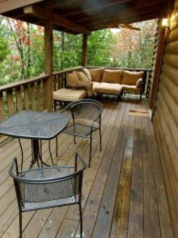 Covered back porch with bbq grill and sectional sofa