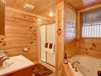 BATHROOM W/ JACUZZI TUB at BEAR CUB HIDEAWAY in Sevier County TN