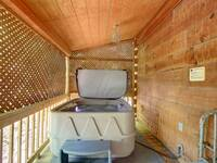 HOT TUB ON SCREENED DECK
