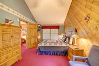 BEDROOM 1 (KING / MAIN LEVEL) at ABOVE THE TREE TOPS in Pigeon Forge TN
