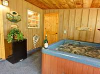 HOT TUB (SCREENED-IN DECK) at THE TREEHOUSE LODGE in Pigeon Forge TN