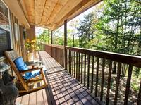DECK & ROCKERS at THE TREEHOUSE LODGE in Pigeon Forge TN
