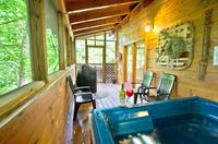 HOT TUB ON SCREENED DECK at WINTER HAVEN in Sevier County TN