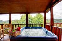 HOT TUB ON SCREENED DECK at BIG BEAR LODGE in Sevier County TN