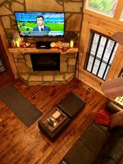 """Living space includes sofa, two ottomans, 55"""" TV and gas fireplace"""