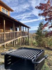Charcoal grill looks out toward the mountains