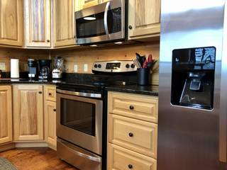 Refrigerator with ice maker in door, stove and microwave