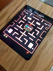PacMan video game on screen of video game table