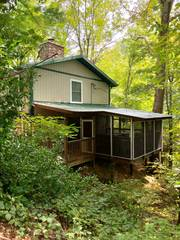 Attached to house is a large screened porch