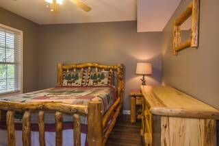 Log furniture in queen bedroom on lower level