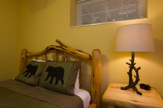 Unique log headboard and nightstand