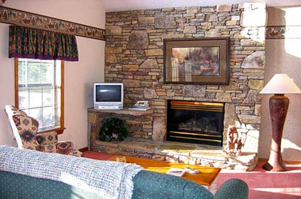 Living Room w/ TV and Fireplace