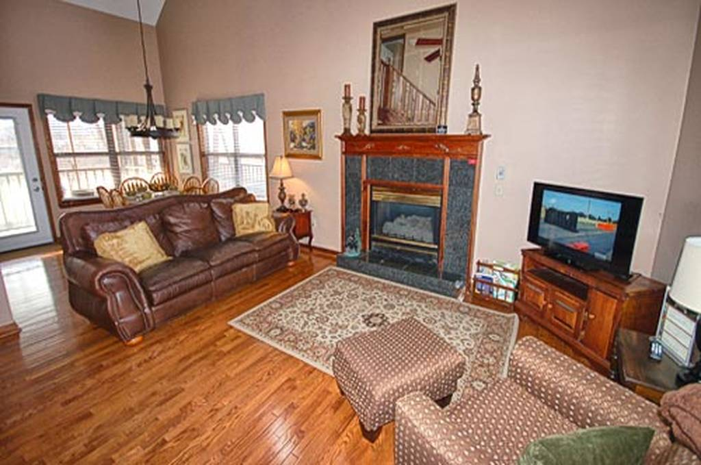 Living room with TV, and Gas Fireplace