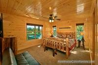 King bedroom with futon couch and tv in A View For All Seasons cabin in Gatlinburg