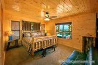King suite in A View For All Seasons cabin near Gatlinburg with futon couch