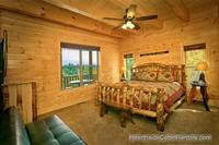 A View for All Seasons cabin near Gatlinburg king bed and futon couch