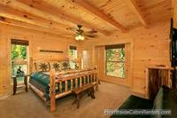 A View for All Seasons cabin near Gatlinburg king bed with wooded view