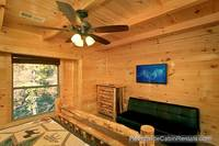 A View for All Seasons cabin near Gatlinburg king bedroom with full-size futon couch and tv