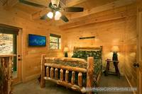 A View for All Seasons cabin near Gatlinburg queen bedroom with flat-screen tv