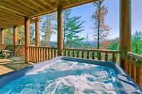 Mountain view from outdoor hot tub at A View For All Seasons cabin near Gatlinburg