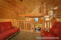 Sitting area and loft at cabin near Gatlinburg A View For All Seasons