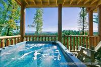 Relaxing outdoor hot tub with mountain view at cabin near Gatlinburg A View For All Seasons