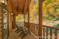A View for All Seasons cabin near Gatlinburg with covered deck and wooded view