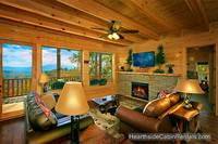 Large living room with electric fireplace at Pigeon Forge cabin Amazing View Manor