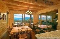 Open dining room with mountain view at Pigeon Forge cabin Grand View Lodge