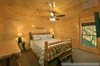 Relaxing king bedroom at A Grand View Lodge cabin in Pigeon Forge