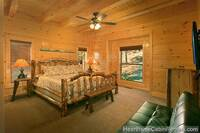 King bedroom with full-size futon at A Grand View Lodge cabin in Pigeon Forge