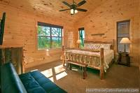 King bedroom with mountain view at A Grand View Lodge cabin in Pigeon Forge