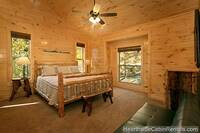 Large king-size bedroom with full-size futon at Pigeon Forge cabin Grand View Lodge
