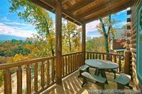 Grand View Lodge Pigeon Forge cabin with covered deck and mountain view