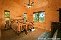 King suite with futon bed and mountain view at Grand View Lodge cabin in Pigeon Forge