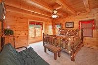 Large queen-sized bedroom in Morning View Manor cabin in Pigeon Forge
