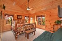 Private queen suite inside large Pigeon Forge cabin rental.