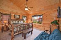 Private king-size suite in Morning View Manor cabin in Pigeon Forge
